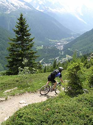 Mountain Bike Guide Riding above the Chamonix Valley, glad that he is not stuck in an office!