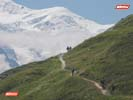 Mountain Bikers riding a singletrack climb with Mont Blanc View